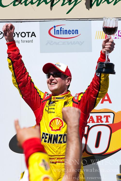 June 26, 2011; Sonoma, CA, USA;  NASCAR Sprint Cup Series driver Kurt Busch (22) celebrates after winning the Toyota/Save Mart 350 at Infineon Raceway.