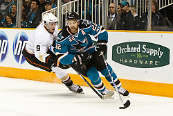November 9, 2010; San Jose, CA, USA;  San Jose Sharks defenseman Dan Boyle (22) clears the puck past Anaheim Ducks right wing Bobby Ryan (9) during the first period at HP Pavilion. Mandatory Credit: Jason O. Watson / US PRESSWIRE