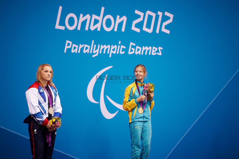 Charlotte Henshaw of Great Britain and Viktoriia Savsova of the Ukraine in the women's 100 meter breaststroke SB6 medal Ceremony at the Aquatics Centre on day 7 of the London 2012 Paralympic Games. 5th September 2012.