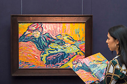 "© Licensed to London News Pictures. 20/02/2019. LONDON, UK. A staff member views ""Mädchen auf dem Diwan (Girl on a Divan""), 1906, by Ernst Ludwig Kirchner (Est. £2.8-3.8m). Preview of Sotheby's Impressionist & Modern and Surrealist Art sales.  The auction will take place at Sotheby's New Bond Street on 26 February 2019.  Photo credit: Stephen Chung/LNP"