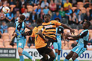Wycombe Wanderers player Dan Rowe and Barnet player John Akinde compete for a high ball during the Sky Bet League 2 match between Barnet and Wycombe Wanderers at The Hive Stadium, London, England on 15 August 2015. Photo by Bennett Dean.