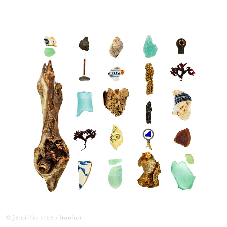 Beachcombing in Maine in March is something of an endurance test, so 30&ordm;F felt like a spring thaw. I headed straight for my favorite (most interestingly garbage-strewn) beach. <br /> <br /> Pottery shards from the late 1800s to 1960s, sea glass, driftwood, coal, metal knob, Irish Moss seaweed (Chondrus crispus), Dog Whelk (Nucella lapillus), wallpaper, corncob, soda can pull-tab, bone, and plastic knob. The bottle necks are typical of early 20th-century soda bottles.