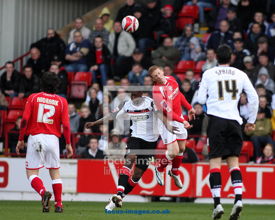Barnsley - Saturday 21st February 2009 : Bobby Hassell of Barnsley & Trésor Kandol of Charlton Athletic in action during the Coca Cola Championship match at Oakwell, Barnsley. (Pic by Steven Price/Focus Images)