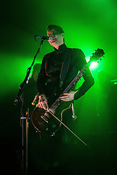 © Licensed to London News Pictures . 03/03/2013 . Manchester , UK . Jónsi Birgisson plays his guitar with a cello bow . Sigur Ros perform live at the 02 Apollo Manchester . Photo credit : Joel Goodman/LNP