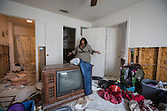 Carletta Cannon, victem of the 1000-year flood that hit Louisiana, surveys the extensive damage to her home and belongings on Sept. 3, 2016 in the Townhomes of Sherwood Forest complex in Baton Rouge. Cannon has been displaced by the flood and said all of her clothes were destroyed.