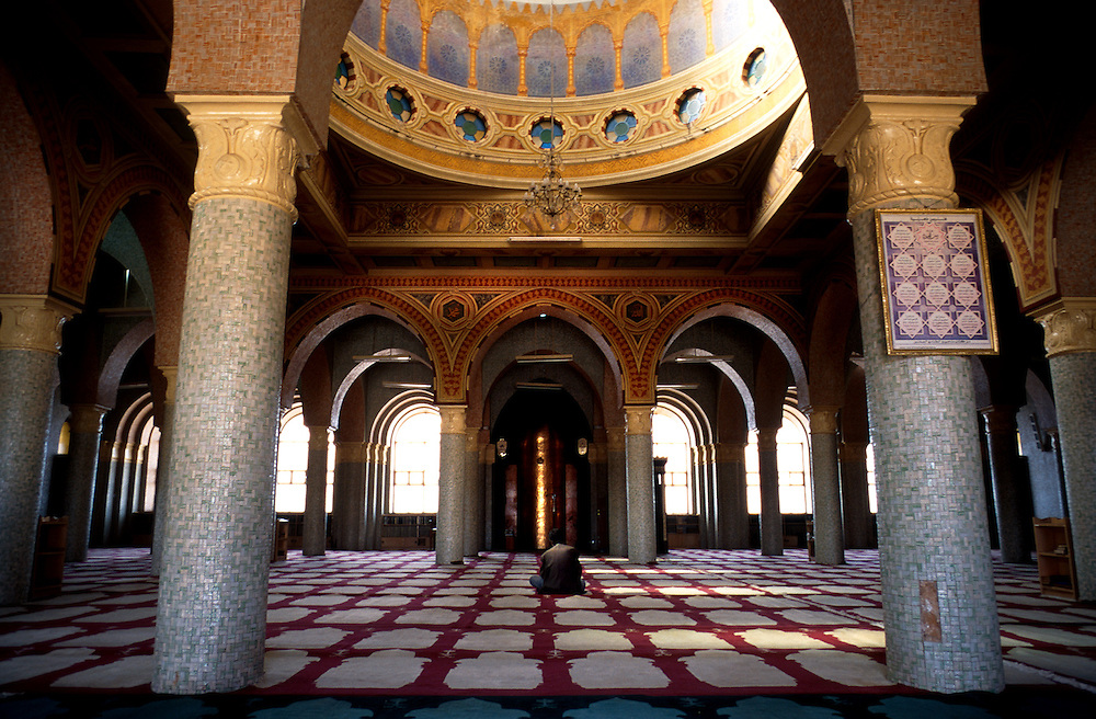 A Muslim man sits for prayers in main room of the Al Qurafi al Rashidin Mosque ('Followers of the Right Path') which was built in 1937 by Italian architects in Asmara, Eritrea.