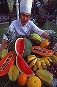 Tropical fruits and Singapore chef, still life