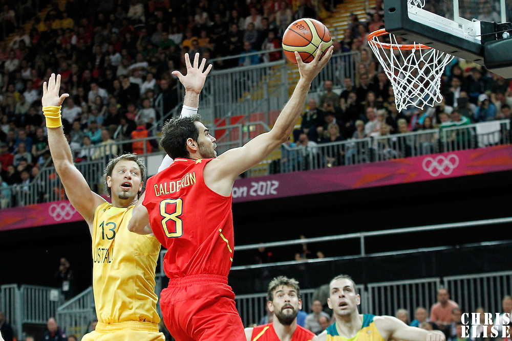 31 July 2012: Spain Jose Calderon goes for the layup past Australia David Andersen during the first half of Spain vs Australia, during the men's basketball preliminary, at the Basketball Arena, in London, Great Britain.