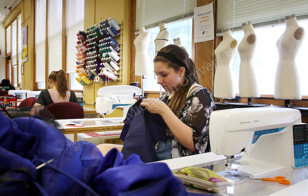 A high school student works on her garment during Fashion Camp photo by Emily Mesner