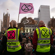 Thousands of Extinction Rebellion activists took over 5 bridges in Central London and blocked them for the day, November 17 2018, Central London, United Kingdom. A final vigil and multi-faith prayer service finished the day of rebellion in Parliamnet Square. Around 11am people on all bridges sat down in the road and blocked traffic from coming through and stayed till late afternoon. The actvists believe that the government is not doing enough to avoid catastrophic climate change and they demand the government take radical action to save future generations and the planet. Many are willing to be arrested peacefully protesting and up to 80 were arrested on the day. Extinction Rebellion is a grass root climate change group started in 2018 and has gained a huge following of people commited to peaceful protests and who ready to be arrested. Their major concern is that the world is facing catastropohic climate change and they want the British government to act now to save future generations.