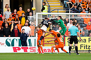 Dundee United goalkeeper Harry Lewis (#25) punches the ball clear as Dundee defender Kerr Waddell (#34) looks to connect with a header during the Betfred Scottish Cup match between Dundee and Dundee United at Dens Park, Dundee, Scotland on 9 August 2017. Photo by Craig Doyle.