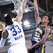 Delaware 87ers Guard Jamal Jones (22) drives towards the basket as Reno Bighorns Center Ty Walker (33) defends in the first half of a NBA D-league regular season basketball game between the Delaware 87ers and the Reno Bighorns (Sacramento Kings), Tuesday, Feb. 10, 2015 at The Bob Carpenter Sports Convocation Center in Newark, DEL
