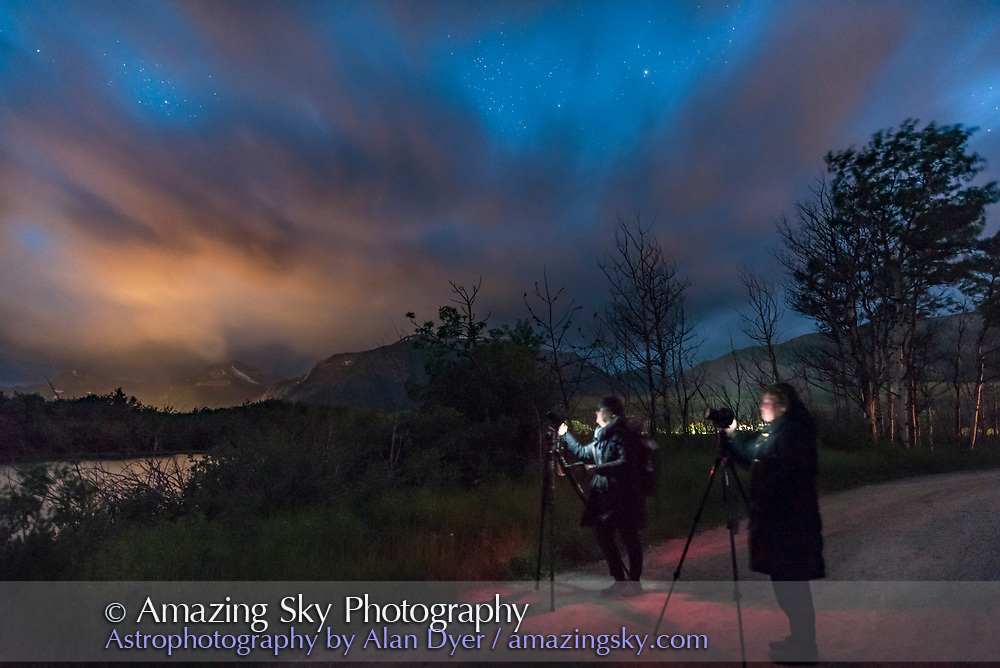 Participants at my Night Photography Workshop on JUne 15, 2017 at Maskinonge Pond at Waterton Lakes National Park, Alberta, on a mostly cloudy night. Lights from the Waterton townsite light the clouds.