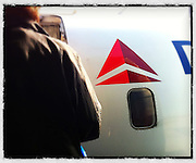 Boarding Delta Airline jet. iPhone 4 with Snapseed app. (Sam Lucero photo)