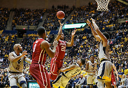Jan 6, 2018; Morgantown, WV, USA; Oklahoma Sooners guard Kameron McGusty (20) shoots in the lane during the first half against the West Virginia Mountaineers at WVU Coliseum. Mandatory Credit: Ben Queen-USA TODAY Sports