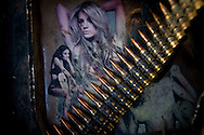 DIYALA PROVINCE, IRAQ - JUNE 11: A string of bullets lays across pictures of women adorning the armor of a stryker vehicle, on June 11, 2010, north of Jalaulah, Diyala Province, Iraq. Iraq faces multiple challenges in the lead-up to the drawn-down of US forces in Iraq, with many observers claiming that while they have the capablities of handling home-grown problems, they are far from being able to tackle external threats. Political wrangling has reportedly fostered greater instability throughout the country with fears of renewed sectarian violence breaking out as insurgents set-up attacks in an attempt to exploit vulnerabilities amongst the populace. (Photo by Warrick Page)