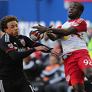 Nick DeLeon, (left), D.C. United and Kemar Lawrence, New York Red Bulls, challenge for the ball during the New York Red Bulls Vs D.C. United, Major League Soccer regular season opening match at Red Bull Arena, Harrison, New Jersey. USA. 22nd March 2015. Photo Tim Clayton