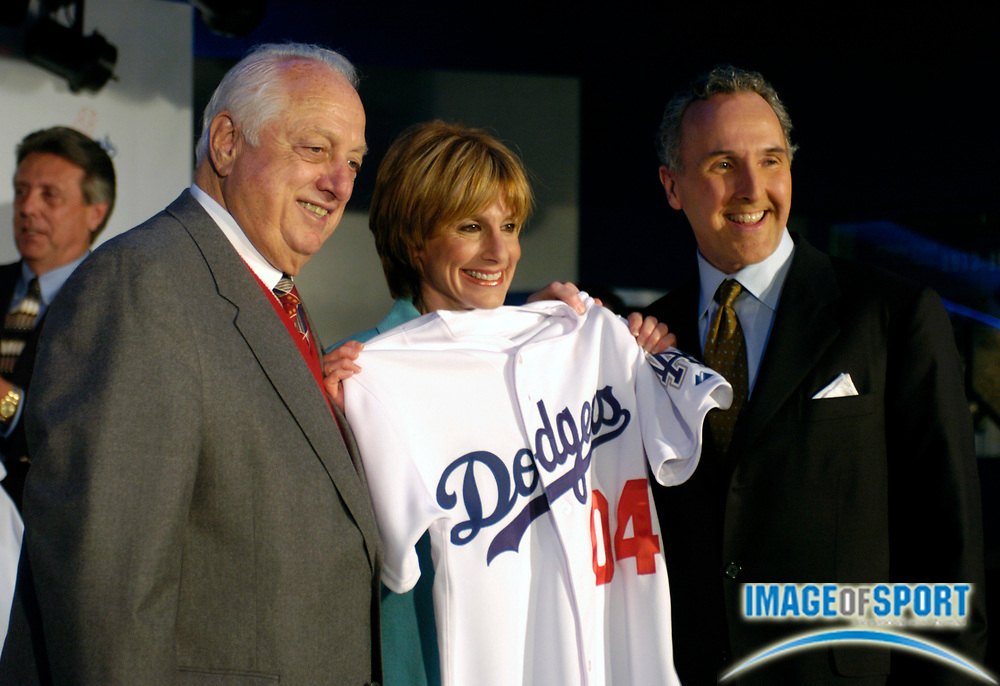 Jan 29, 2004; Los Angeles, CA, USA; Los Angeles Dodgers senior vice president Tommy Lasorda (left) poses with new owners Jamie McCourt and Frank McCourt at press conference announcing McCourts' purchase of team at Dodger Stadium.