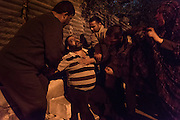 A Palestinian man collapses after an Israeli settler attacked a crowd that had gathered to commemorate the Ibrahimi mosque massacre in Hebron.