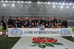 The New Zealand team pose with the Hillary Shield - Photo mandatory by-line: Patrick Khachfe/JMP - Mobile: 07966 386802 08/11/2014 - SPORT - RUGBY UNION - London - Twickenham Stadium - England v New Zealand - 2014 QBE Internationals