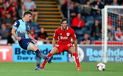 Dayle Southwell of Wycombe Wanderers passes the ball past Adam Matthews of Bristol City - Mandatory by-line: Robbie Stephenson/JMP - 09/08/2016 - FOOTBALL - Adams Park - High Wycombe, England - Wycombe Wanderers v Bristol City - EFL League Cup