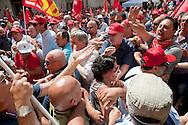 Roma 27 Giugno 2012.Manifestazione  dei sindacati di base  contro la riforma del lavoro e il ministro Fornero..I manifestanti dei sindacati di base vengono fermati in piazza Montecitorio dal servizio d'ordine della CGIL