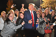 (101615 TYNGSBORO, Ma)-Donald Trump poses with people outside after the rally in Tyngsboro elementary school. Herald photo by Chris Christo