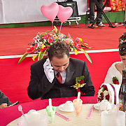 Groom talks on his cellphone, Namasiya Township, Kaoshiung County, Taiwan