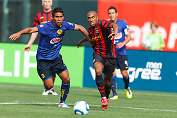 July 16, 2011; San Francisco, CA, USA;  Manchester City defender Gael Clichy (22) dribbles past Club America defender Carlos Valenzuela (6) during the first half at AT&T Park. Manchester City defeated Club America 2-0.