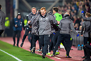 Neil Lennon, manager of Celtic FC celebrates as Odsonne Edouard (#22) of Celtic FC scores the winning goal for Celtic during the Ladbrokes Scottish Premiership match between Heart of Midlothian and Celtic at Tynecastle Stadium, Edinburgh, Scotland on 27 February 2019.