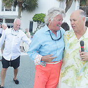 Pat Gilligan,left, dances with Mike Merritt of The Imitations during Lumina Daze Sunday August 24, 2014 at The Blockade Runner in Wrightsville Beach, N.C. (Jason A. Frizzelle)