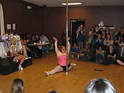 """'It's the first time I've felt sexy in years': 252 pound pole dancer takes on the competitive circuit<br /> <br /> Flicking her bright red hair back, she swings up onto the pole, her thighs gripping the metal while the the audience cheers in applause.<br /> At 252 pounds, LuAyne Barber - stage name Lulu - is not your average pole dancer.<br /> But her ample body, a U.S. size 22, does not hold her back from the lifts, spins, slides, stands and grips that define the dance form's athletic routines.Instead, the 5'4"""" Hanover, Maryland local is perhaps one of the most active in her pole dancing community, regularly competing against the toned, lithe bodies of her peers, since joining the circuit three years ago.<br /> The 26-year-old, who works at a car dealership by day, has been pole dancing for five years, having taken up the unusual hobby in 2006 after having a baby.<br /> <br /> As a former competitive cheerleader and dance student, Ms Barber was no stranger to the stage - but she still had to sum up a lot of courage to strip off and take a pole dancing class.<br /> She told Closer magazine: 'I'd always wanted to try it, but I was worried about what people would think. But when I turned up for my first class and everyone was in stilettos and tiny shorts, regardless their different sizes, I felt a lot better.'<br /> She recalls how, when younger, she did not eat well - and though she wasn't teased at school, she soon became 'ashamed' of her body.<br /> The 'poling' classes changed her outlook: 'I was instantly hooked. It was the first time I'd felt sexy in years.'<br /> Writing on her site, Team-Lulu.com, the mother-of-two says she balances training on the 8-foot metal poles with her family life. She even has a practice pole installed in her home.<br /> And while Lulu has gained something of a fanbase and has a YouTube channel dedicated to her increasingly ambitious moves, her husband, plumber Will Brown, 29, remains her number one fan.<br /> <br /> Photo Shows: At a """