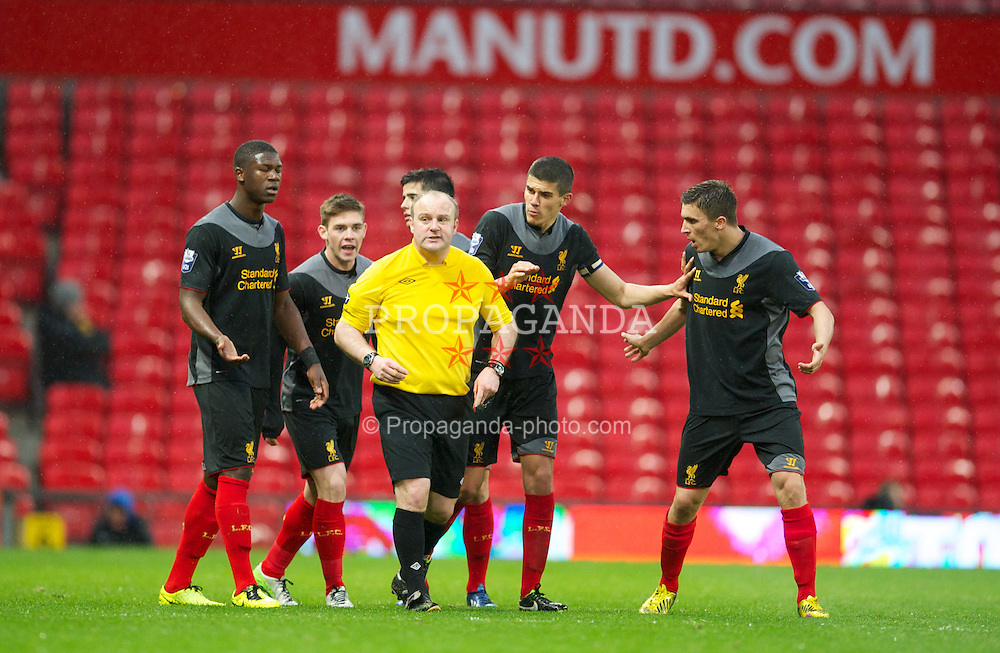 MANCHESTER, ENGLAND - Tuesday, May 14, 2013: Liverpool's Stephen Sama, Jack Dunn, captain Conor Coady and Adam Morgan surround the referee Matthew Walsh after he sent off Jon Flanagan and awarded Manchester United two penalties during the Premier League Academy Elite Group Semi-Final match at Old Trafford. (Pic by David Rawcliffe/Propaganda)