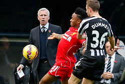 Newcastle United Manager Alan Pardew looks on as Raheem Sterling of Liverpool is challenged by Paul Dummett of Newcastle United - Photo mandatory by-line: Rogan Thomson/JMP - 07966 386802 -01/11/2014 - SPORT - FOOTBALL - Newcastle, England - St James' Park - Newcastle United v Liverpool - Barclays Premier League.