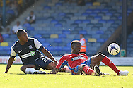 Picture by David Horn/Focus Images Ltd +44 7545 970036.08/09/2012.Britt Assombalonga (l)  of Southend United scores his second goal of the game and Abu Ogogo (r) of Dagenham and Redbridge is unable to prevent the goal during the npower League 2 match at Roots Hall, Southend.