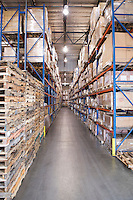 Wooden pallets and cardboard boxes in distribution warehouse
