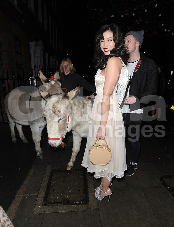 Daisy Lowe wearing her wings arrives at the Love Magazine Christmas party in London. UK. 17/12/2013<br />BYLINE MUST READ : GOTCHAIMAGES.COM<br /><br />Copyright by &copy; Gotcha Images Ltd. All rights reserved.<br />Usage of this image is conditional upon the acceptance <br />of Gotcha Images Ltd, terms and conditions available at<br />www.gotchaimages.com