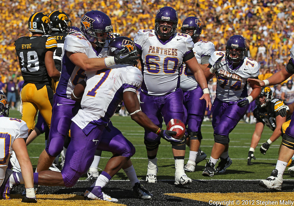 September 15 2012: Northern Iowa Panthers running back David Johnson (7) celebrates with Northern Iowa Panthers tight end Sam Rohr (87) and Northern Iowa Panthers offensive linesman Brian Palangi (60) after his 1 yard touchdown run during the first quarter of the NCAA football game between the Northern Iowa Panthers and the Iowa Hawkeyes at Kinnick Stadium in Iowa City, Iowa on Saturday September 15, 2012. Iowa defeated Northern Iowa 27-16.