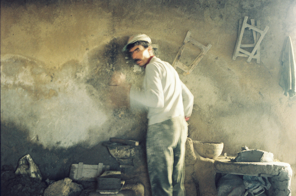 A man works in the ceramic souk in the medina of Fez, Morocco, 1997.