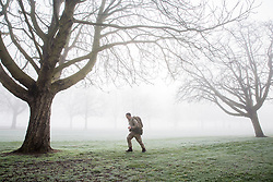 Windsor, UK. 31st January, 2019. A soldier trains in foggy conditions alongside the Long Walk in Windsor Great Park. There are two barracks in Windsor, the Victoria Barracks which currently houses the 1st Battalion Coldstream Guards and the Combermere Barracks which houses the Household Cavalry Regiment. Freezing fog patches are expected to clear slowly in south-east England during the morning, to be followed by cloud, sleet and snow in the east.