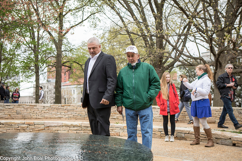 Monacan Chief, Dean Branham, left and his cousin, Branch Branham, survey the new monument, Mantle: Virginia Indian Tribute, built on the Virginia State Capitol Square, in Richmond, Virginia, on Tuesday, April 17, 2018. John Boal Photography