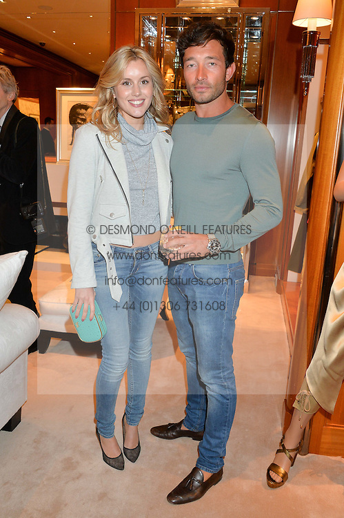 CAGGIE DUNLOP and SCOTT SULLIVAN at a party to celebrate the publication of Front Roe by Louise Roe held at Ralph Lauren, 1 New Bond Street, London on 1st April 2015.