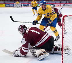 15.05.2012, Ericsson Globe, Stockholm, SWE, IIHF, Eishockey WM, Schweden (SWE) vs Lettland (LVL), im Bild Sverige Sweden 33 Jakob Silfverberg, Latvia 1 Goalkeeper Maris Jucers (Dinamo Riga) // during the IIHF Icehockey World Championship Game between Schweden (SWE) vs Latvia (LVL) at the Ericsson Globe, Stockholm, Sweden on 2012/05/15. EXPA Pictures © 2012, PhotoCredit: EXPA/ PicAgency Skycam..***** ATTENTION - OUT OF SWE *****
