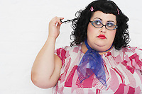 Overweight Woman twisting strand of hair portrait