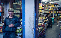 THIMPHU, BHUTAN - CIRCA OCTOBER 2014: Bhutanese man standing outside a general store in Thimpu, Bhutan