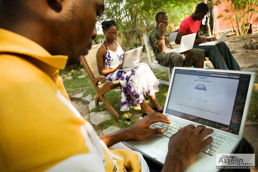 Students use laptops to browse the internet over a wireless network at the Kokrobitey Institute in the town of Kokrobitey, 30km west of Ghana's capital Accra on Sunday January 18, 2009. From left to right Joshua Sarbah, Nana Ama Bentsi-Enchill, Kenful Agbemenya, Simon Mensah.