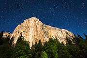 El Capitan under a starry moonlit night (climber's headlamps visible), Yosemite National Park, California USA