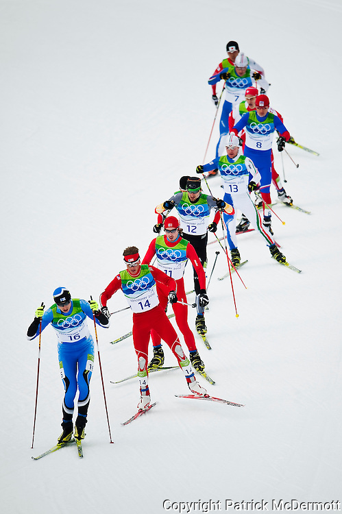 Hannu Manninen of Finland leads the first chase pack during the Men's Individual Nordic Combined Large Hill/10km race during the 2010 Vancouver Winter Olympics in Whistler, Canada, on Feb. 25, 2010.