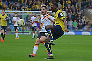 Oxford United defender Cheyenne Dunkley (33) clears from Bradford City midfielder Marc McNulty (18) 0-0 during the EFL Sky Bet League 1 match between Oxford United and Bradford City at the Kassam Stadium, Oxford, England on 15 October 2016. Photo by Alan Franklin.