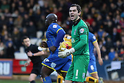James Shea (Goalkeeper) of AFC Wimbledon lets  the linesman know his thoughts during the Sky Bet League 2 match between Cambridge United and AFC Wimbledon at the R Costings Abbey Stadium, Cambridge, England on 2 January 2016. Photo by Stuart Butcher.